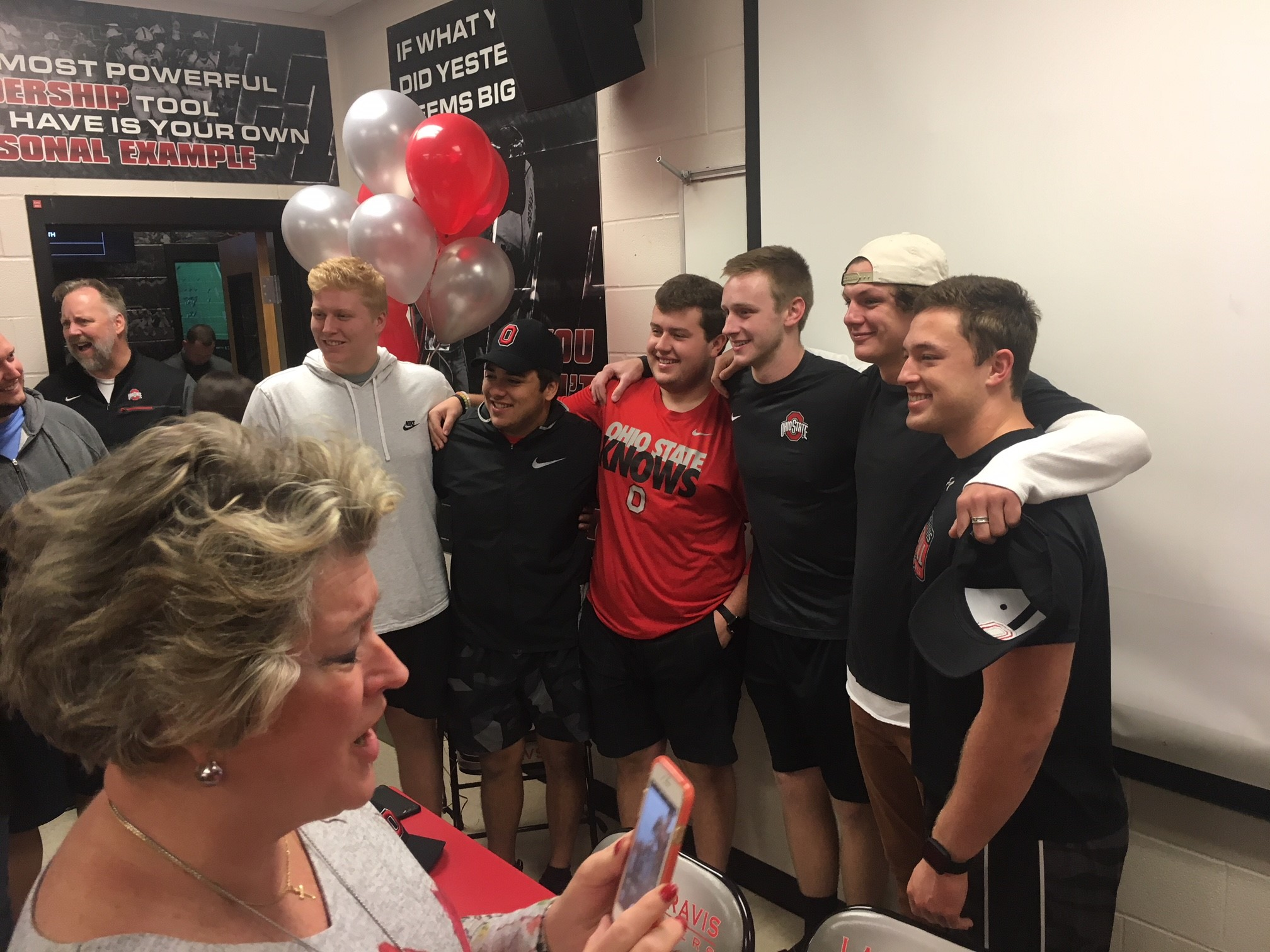 Lake Travis High athlete Matthew Baldwin signs his letter of intent with Ohio State University on Dec. 21, 2017. (KXAN Photo/Todd Bynum)