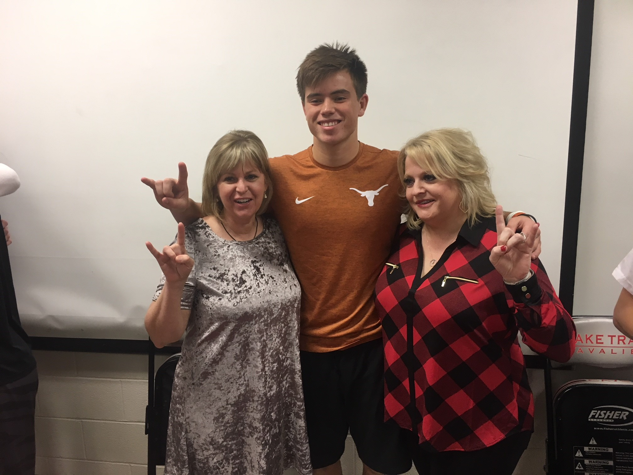 Lake Travis High athlete Cameron Dicker signs his letter of intent with the University of Texas at Austin on Dec. 21, 2017. (KXAN Photo/Todd Bynum)