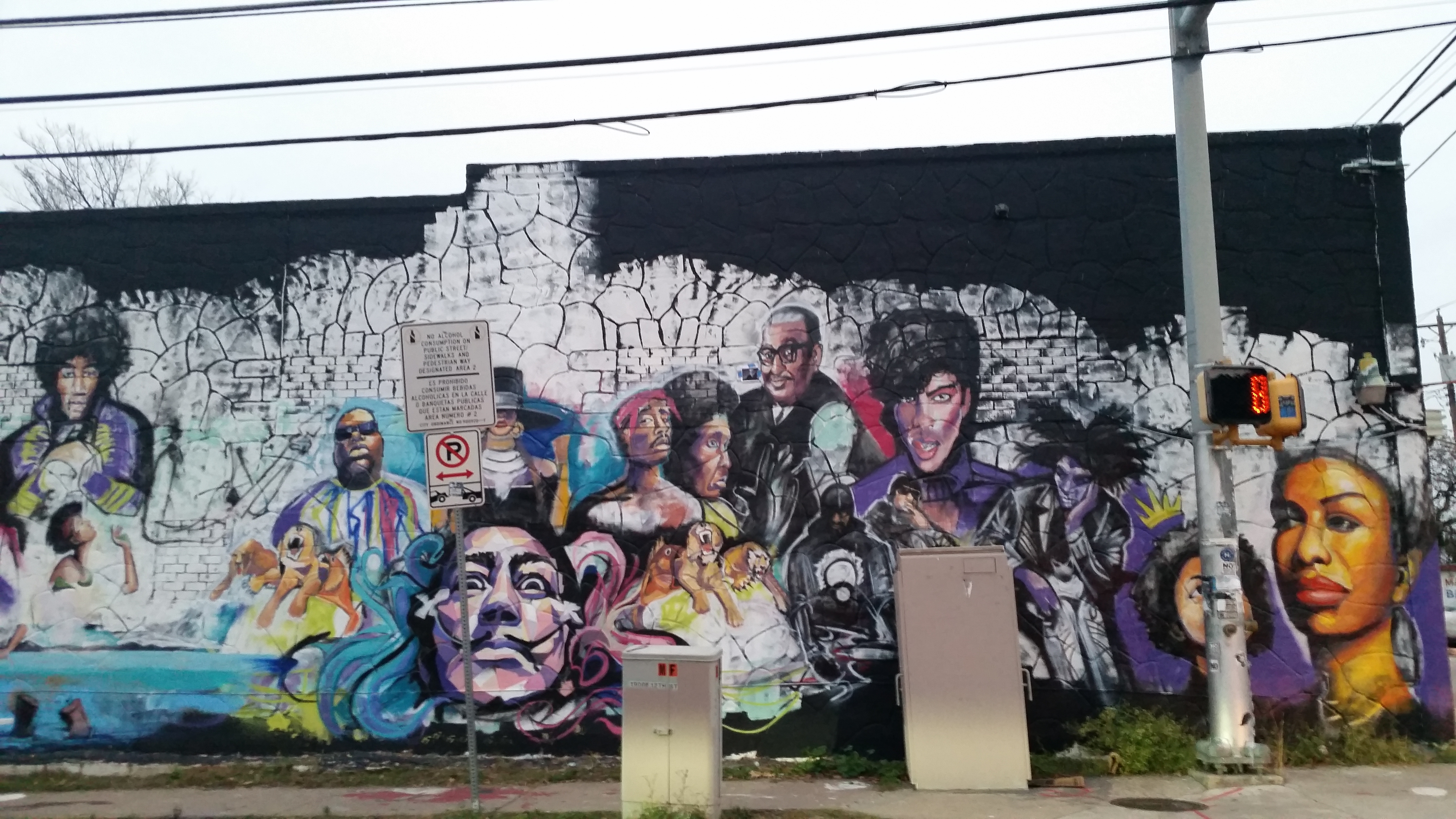 A mural at 12th and Chicon streets features prominent local and national musical and artistic icons (KXAN Photo/Calily Bien)