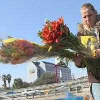 Leslie Valdez honors crash victims at crash site._609491