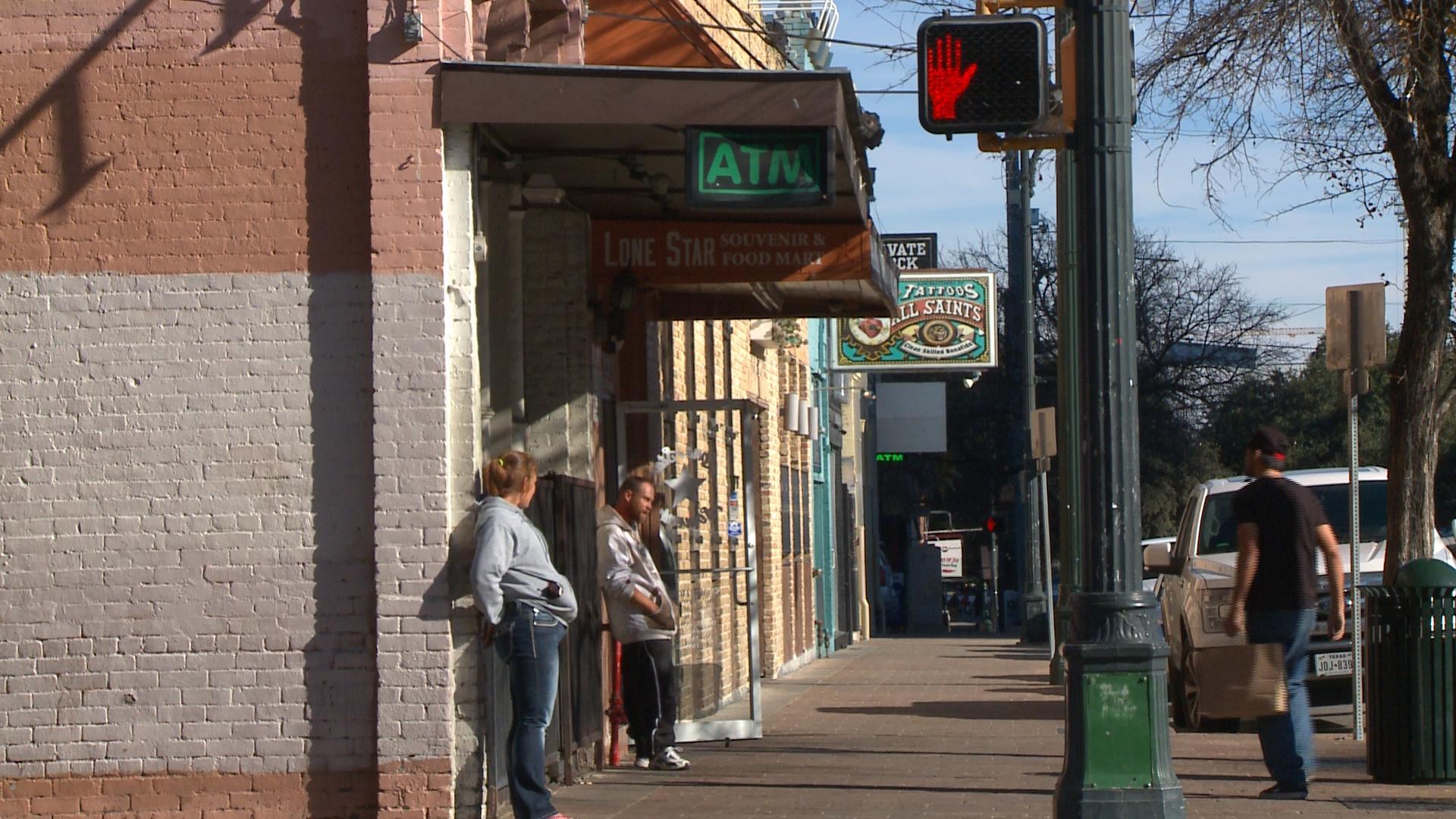 People standing on Austin's East Sixth Street. (KXAN Photo/ Alyssa Goard).