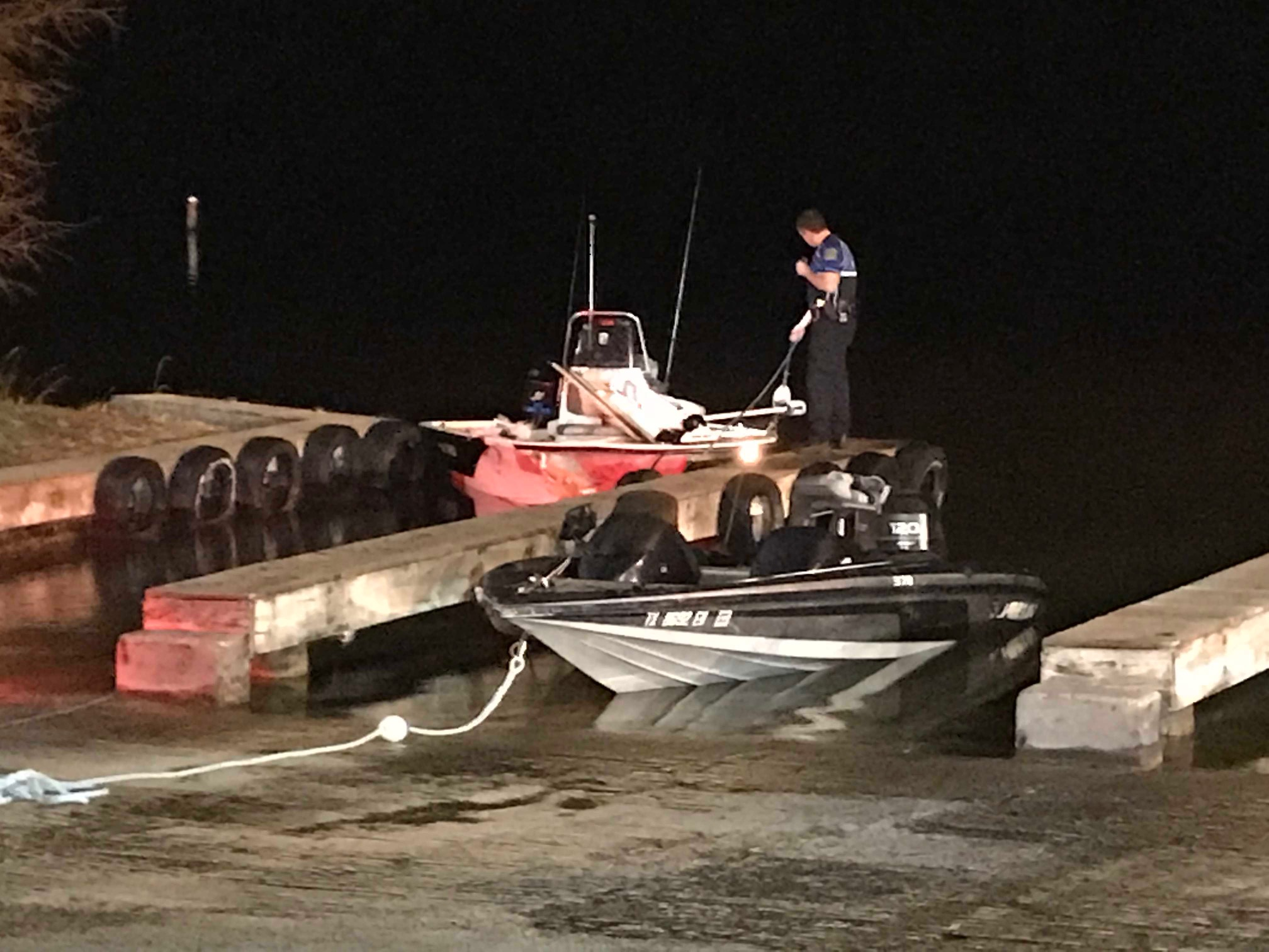 Austin officials survey two boats that crashed on Lake Austin near the Loop 360 bridge on Jan. 23, 2018 (KXAN Photo/Tim Holcomb)