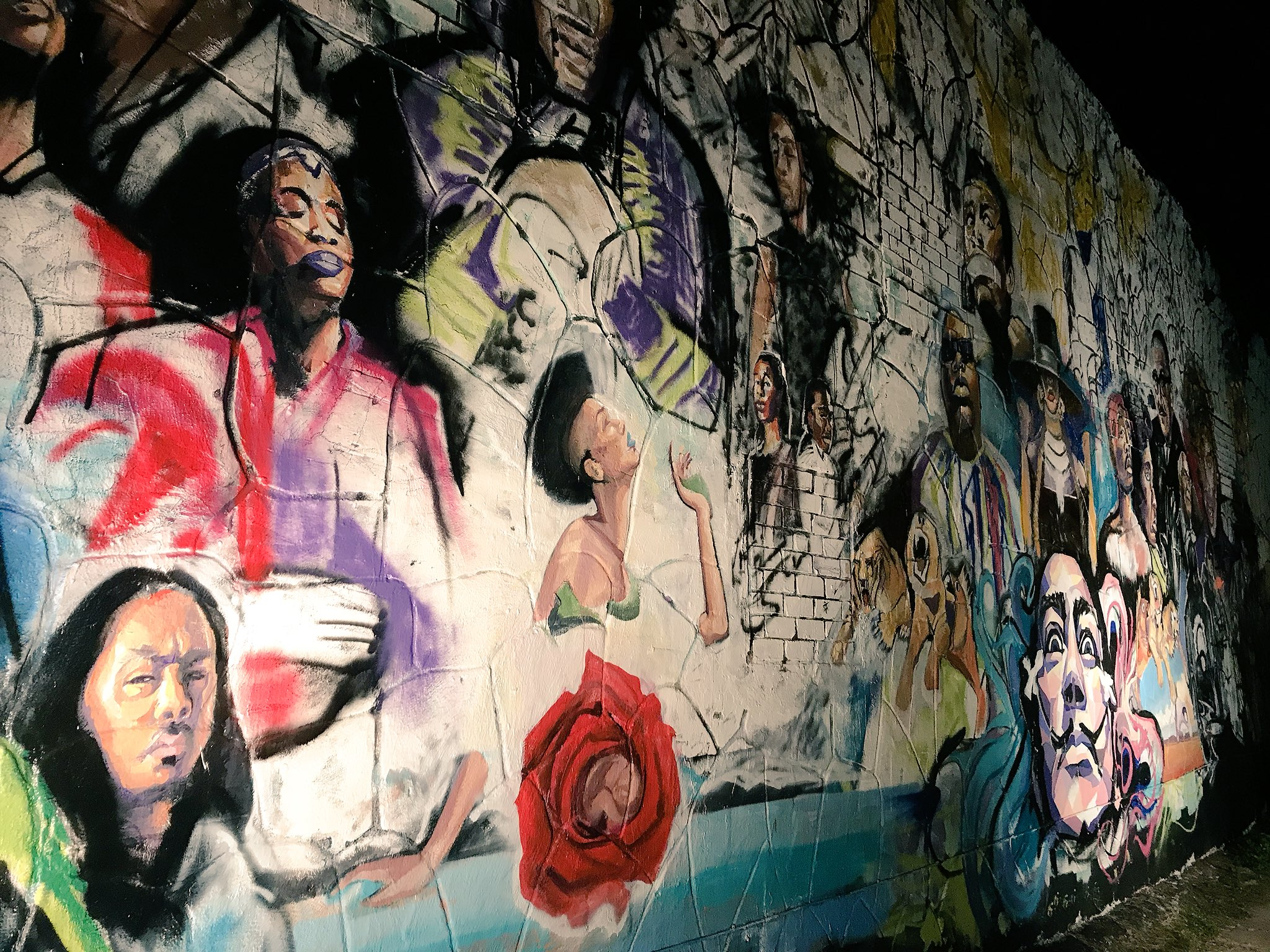 A mural at 12th and Chicon streets features prominent local and national musical and artistic icons (KXAN Photo/Todd Bailey)