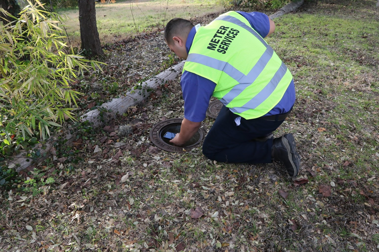 A meter reader taking a photograph of the water meter. (Courtesy: City of Austin)