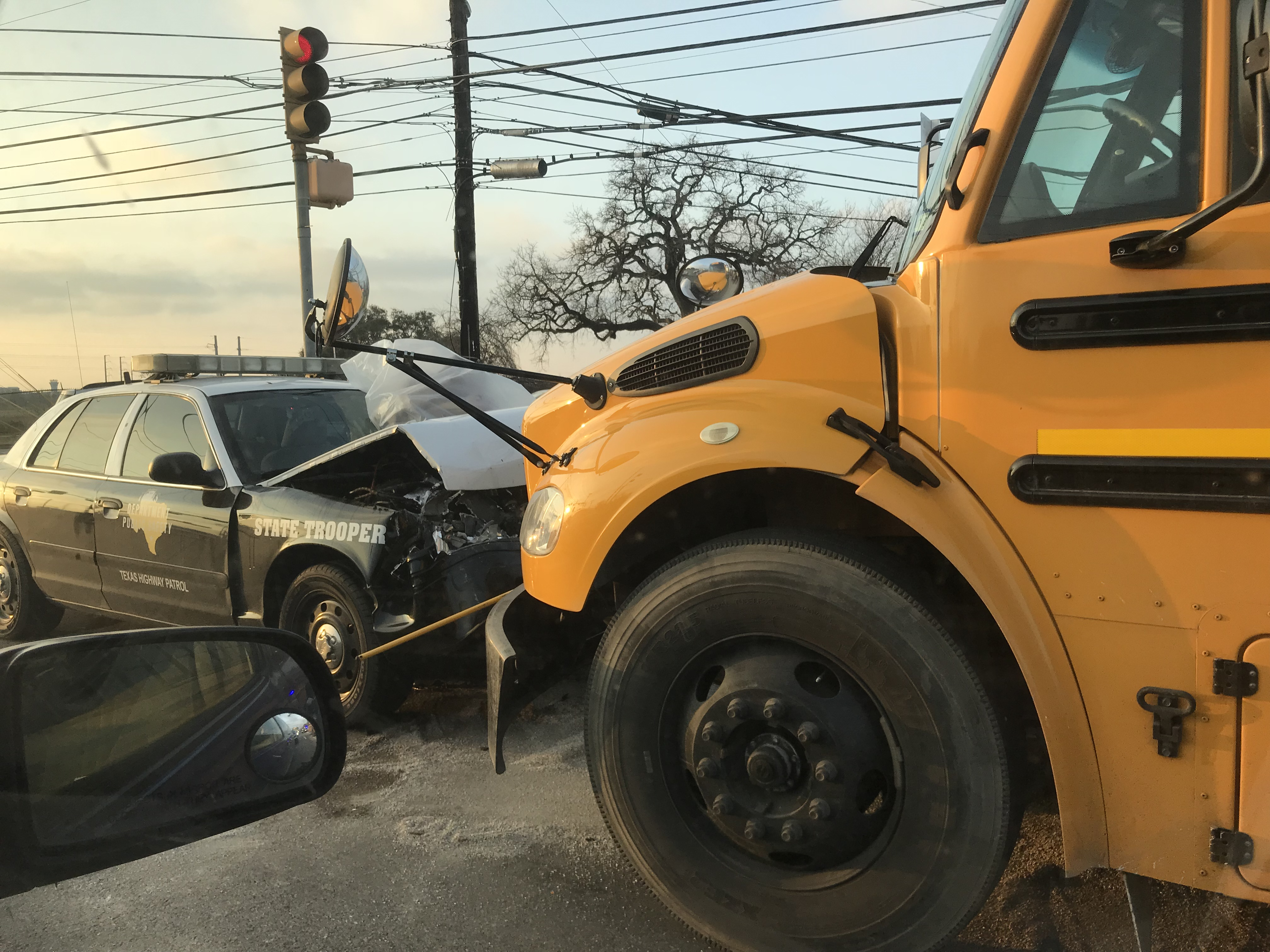 DPS trooper crashes with school bus, SUV in east Austin