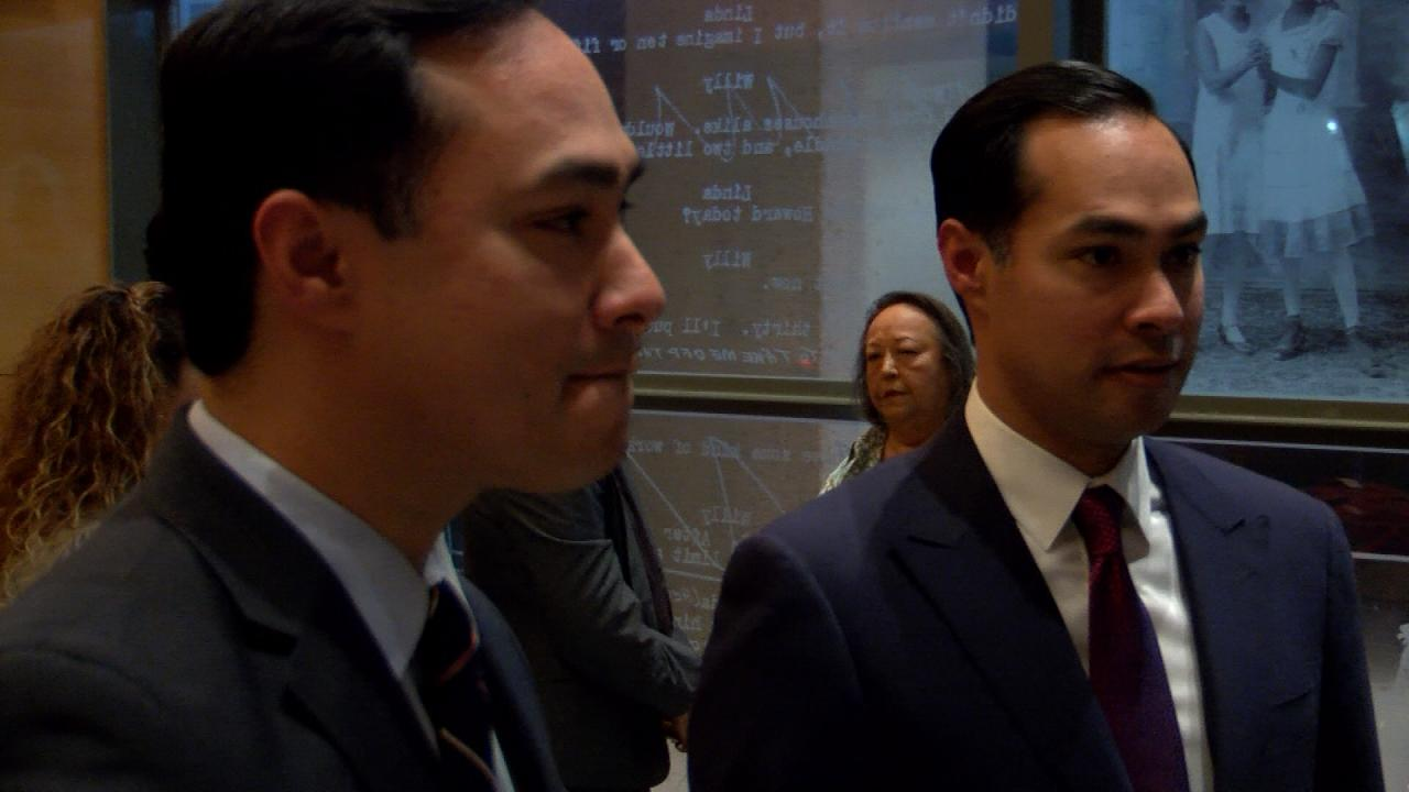 Former Housing and Urban Development Secretary Julian Castro (right) speaks to attendees of a panel discussion with his mother and brother, U.S. Rep Joaquin Castro (left), at UT Austin on Feb. 19, 2018. (Nexstar Photo/Wes Rapaport)