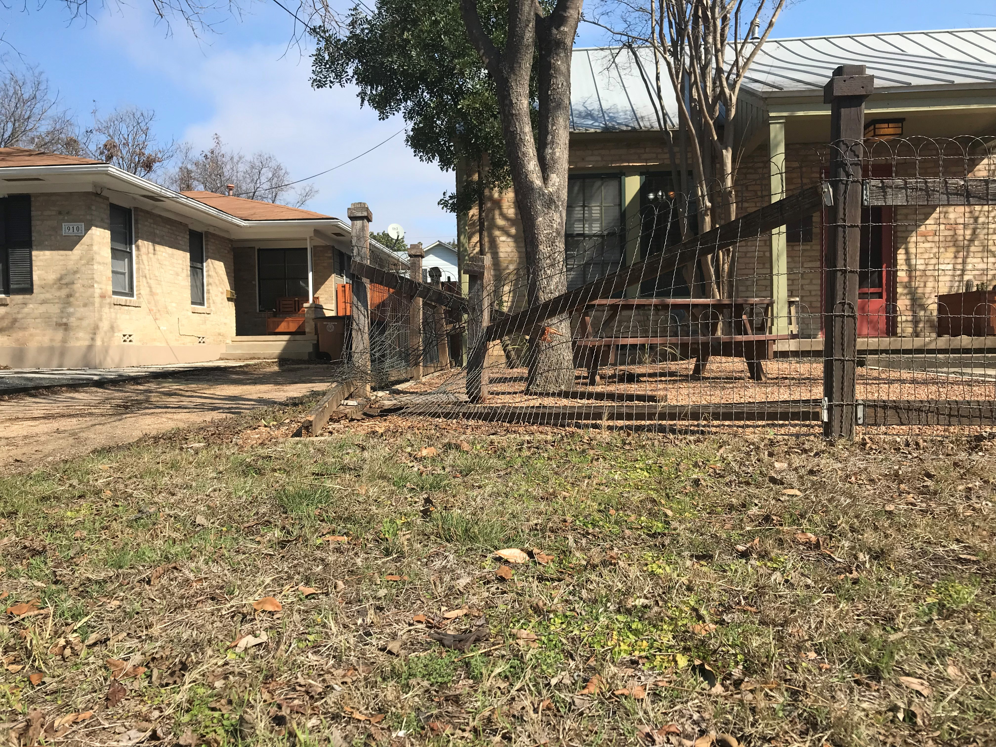 A homeowner's fence that was damaged when police say Olivia Gruwell ran into it on Feb. 9, 2018. (KXAN Photo/Yoojin Cho)