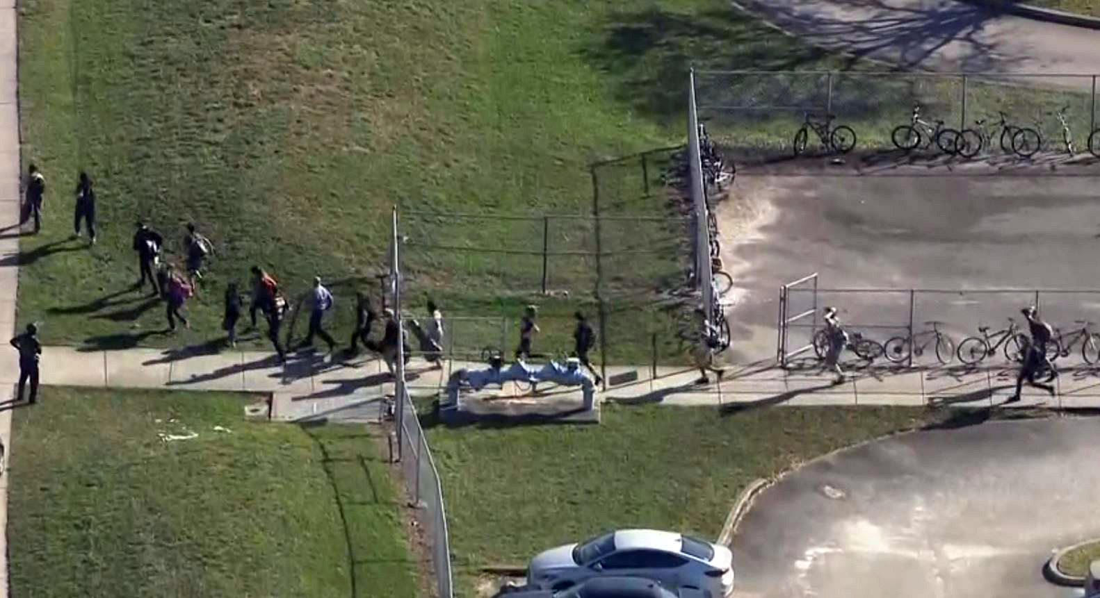 Students evacuating Marjory Stoneman Douglas High School on Feb. 14, 2018. (NBC Photo)