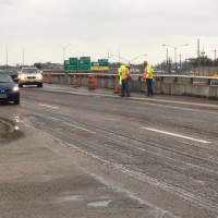Crews fill in a gaping hole on the frontage road_640494