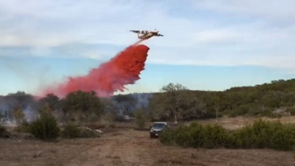 Texas A&M Forest Service tanker dropping retardant on a brush fire in Wimberley on Tuesday, Jan. 30, 2018. (Courtesy: Bob Fireman)