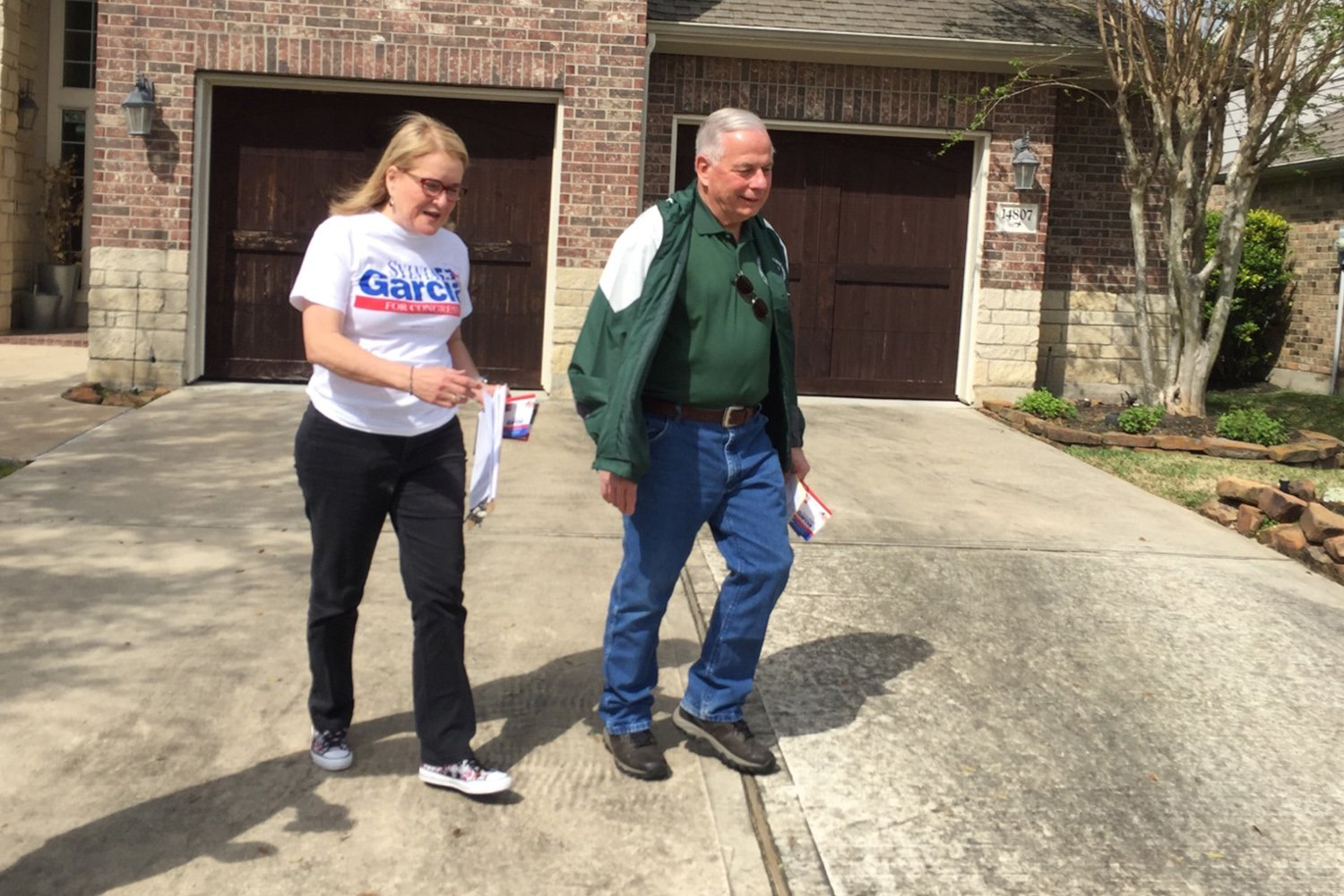 State Sen. Sylvia Garcia and U.S. Rep. Gene Green were knocking on doors in Humble for her congressional campaign on Saturday, March 3, 2018.  Abby Livingston/Texas Tribune