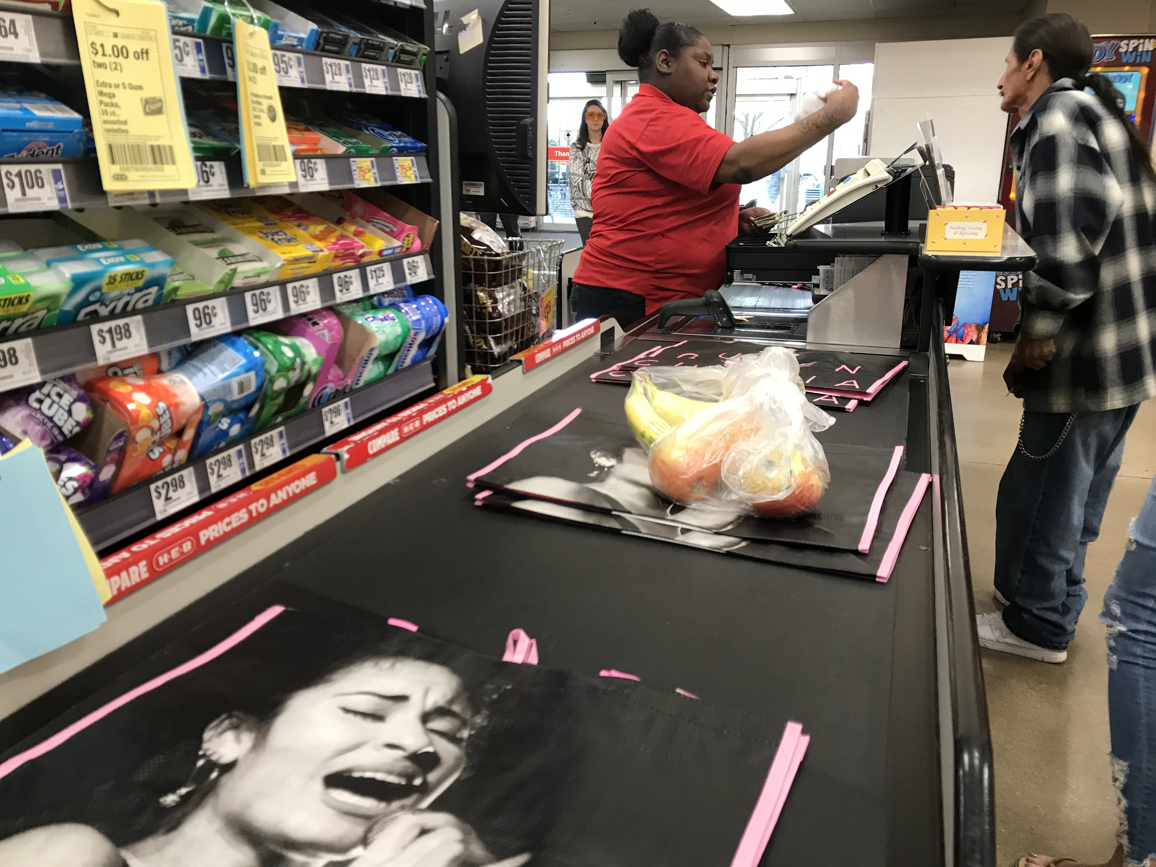 An H-E-B cashier rings up limited-edition Selena bags for customers in Austin March 2, 2018 (KXAN Photo/Jose Torres)