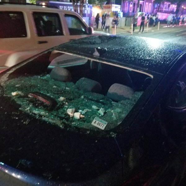 A car window shattered during heavy winds on Rainey Street