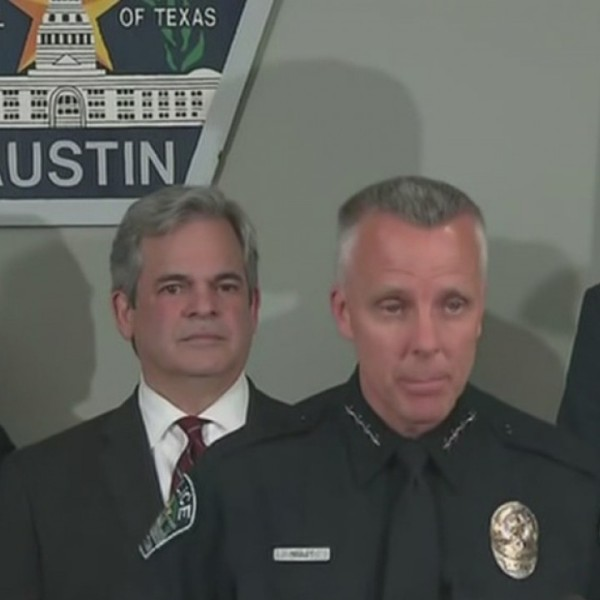 Interim Chief Manley, second from right, and City Manager Spencer Cronk, at right