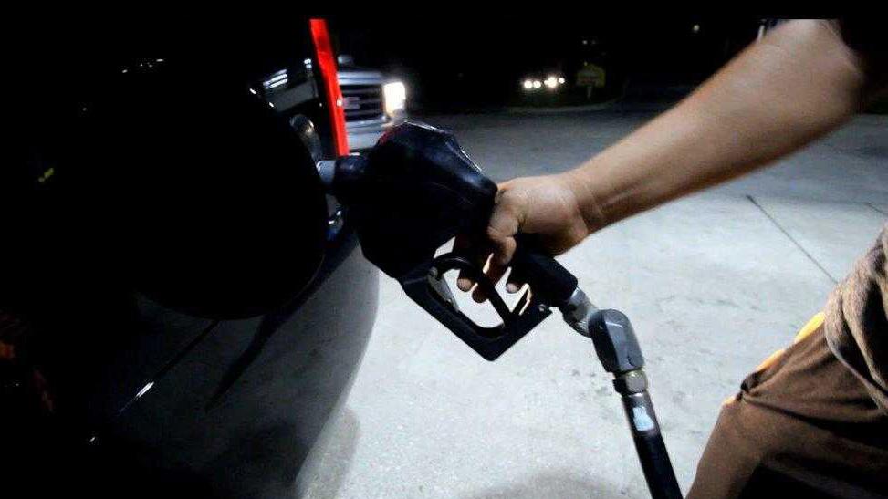 FILE - Gas station pump nozzle