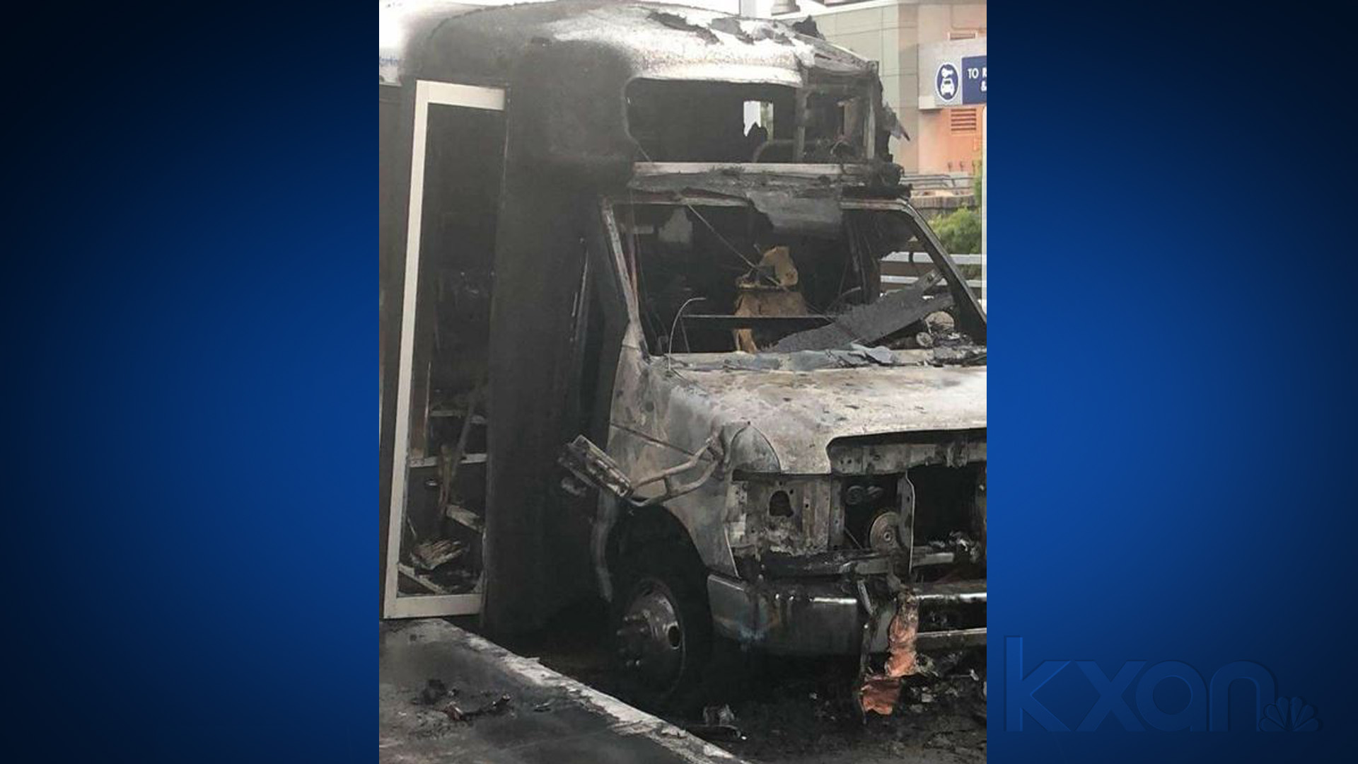 The charred remains of a shuttle bus that caught fire at Austin airport