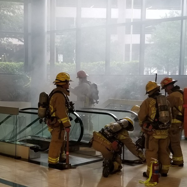 Escalator smoking in Travis County Administration Building at 700 Lavaca St.