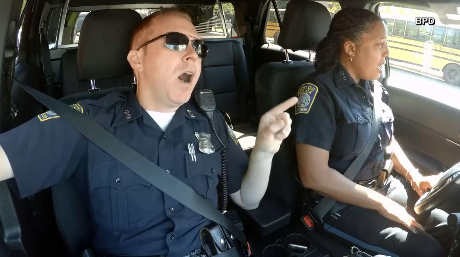 singing boston officers_1530544271873.JPG.jpg