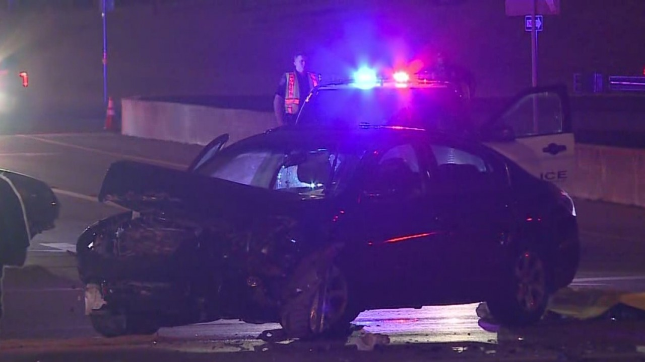 A woman in her 30s was killed Wednesday night in a crash in the intersection of eastbound Koenig Lane and the southbound Interstate 35 service road.