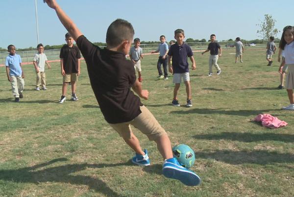kid playing soccer_1535106412934.PNG.jpg