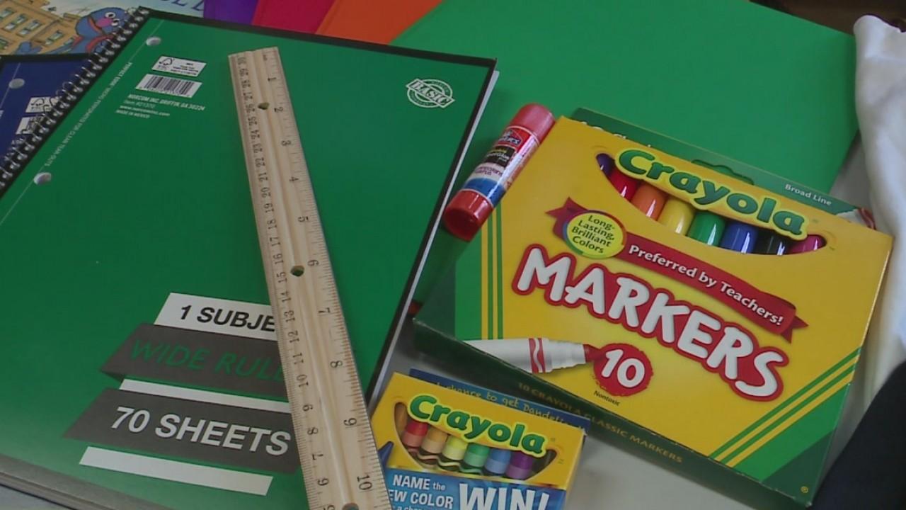 School supplies, ruler, notebook, markers