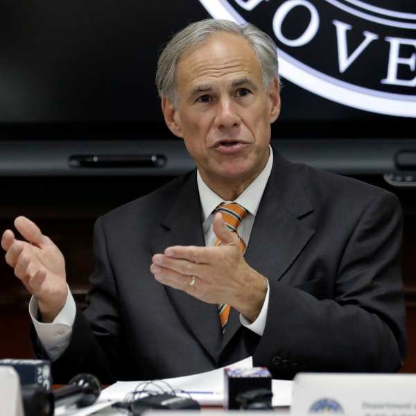 Greg Abbott addressing state officials