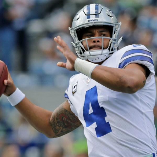 Dallas Cowboys quarterback Dak Prescott passes during warmups