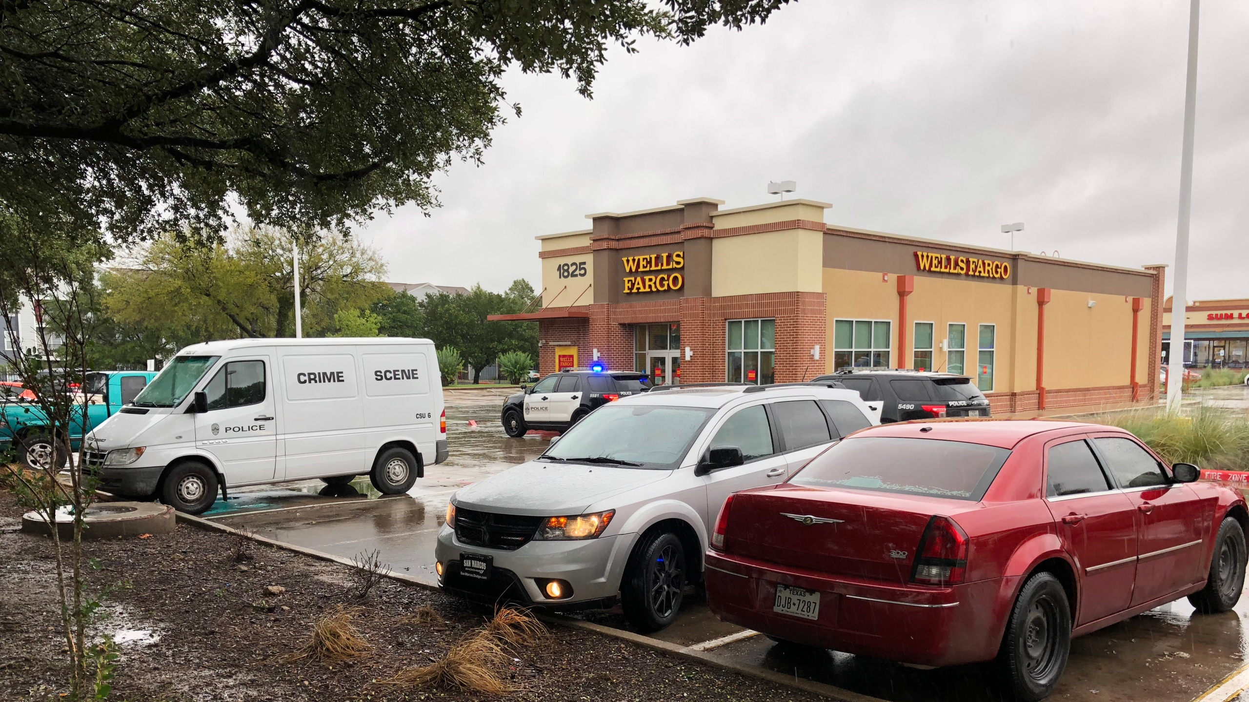 Police at the scene of a bank robbery at the Wells Fargo branch at 1825 S. Pleasant Valley Rd. 2