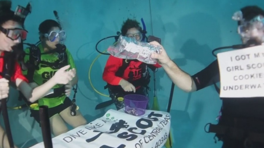 Scuba_diving_girl_scouts_sell_cookies_wh_1_20190216164225