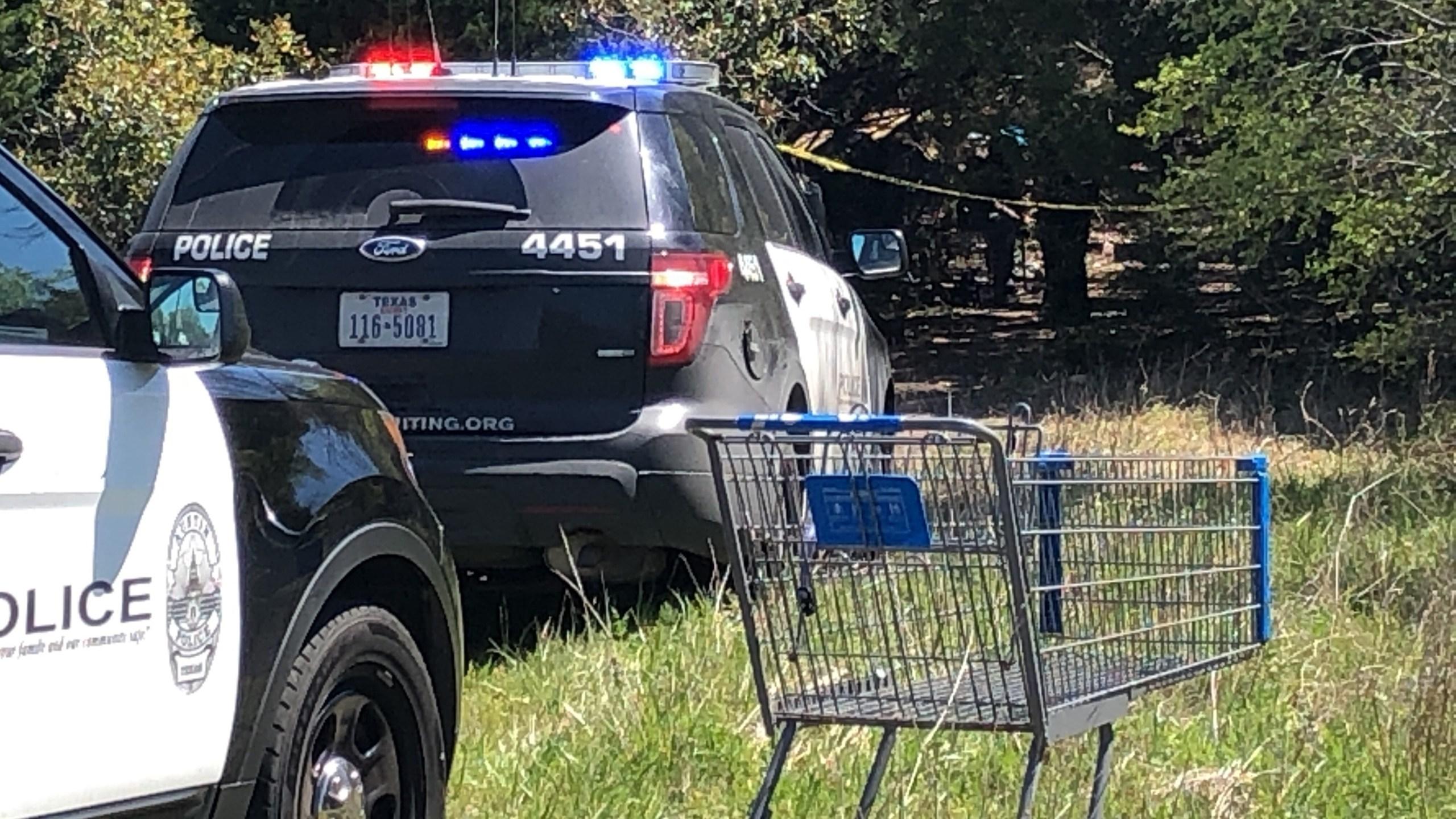 Police investigating dead body found in vacant field near