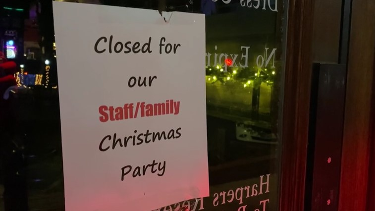 Picture of sign showing Harper's closed for holiday party