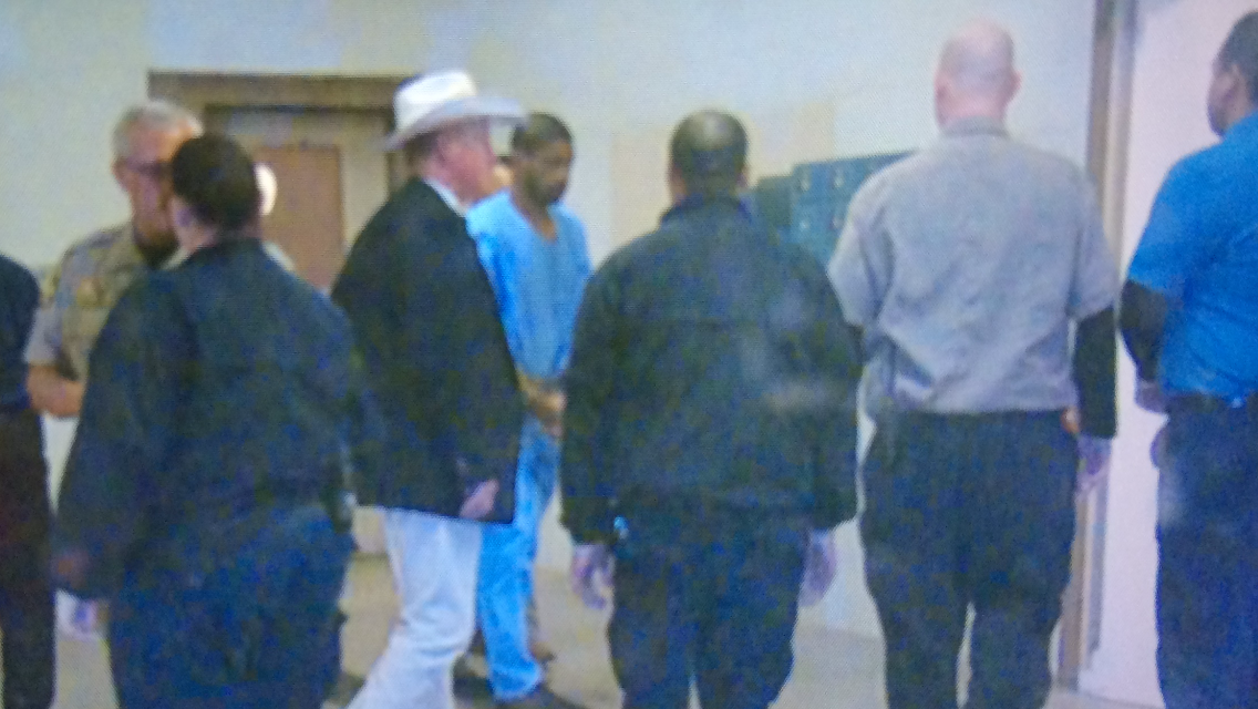 VonTrey Clark (in blue) as he was booked into the Bastrop County Jail Sept 2nd, 2015. (Juan Salinas/KXAN News)