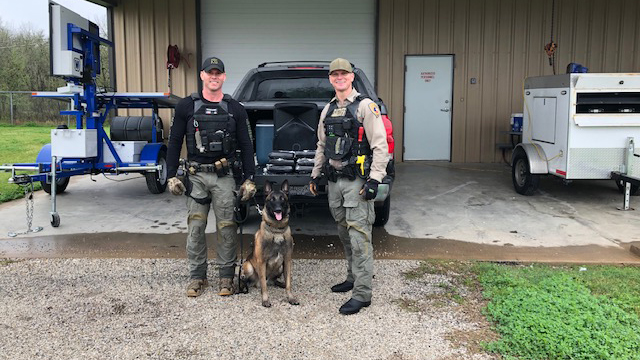 Sgt Randy Thumann, K9 Kolt and Investigator Smith with cocaine found in a karaoke machine (Fayette County Sheriff's Office Photo)