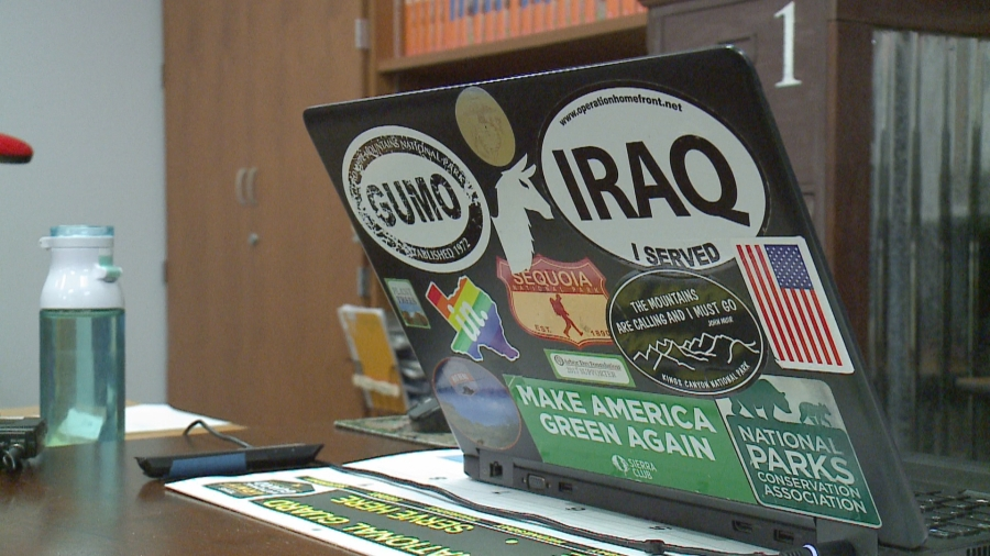 Micki Eubanks' computer in her classroom boasts stickers related to her passions (KXAN Photo/Andrew Choat)