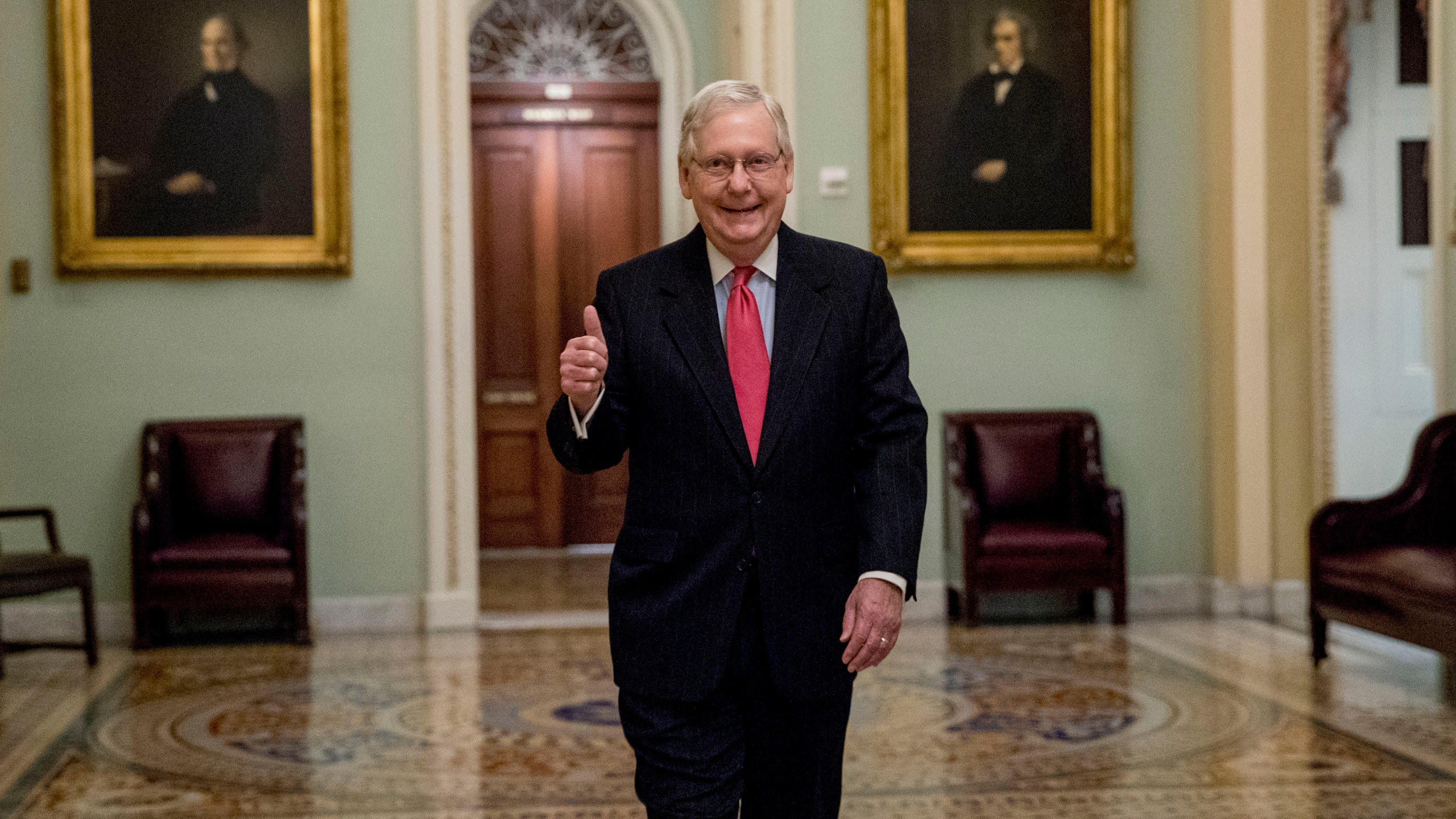 Senate Majority Leader Mitch McConnell of Ky. gives a thumbs up as he arrives on Capitol Hill, Wednesday, March 25, 2020, in Washington. (AP Photo/Andrew Harnik)