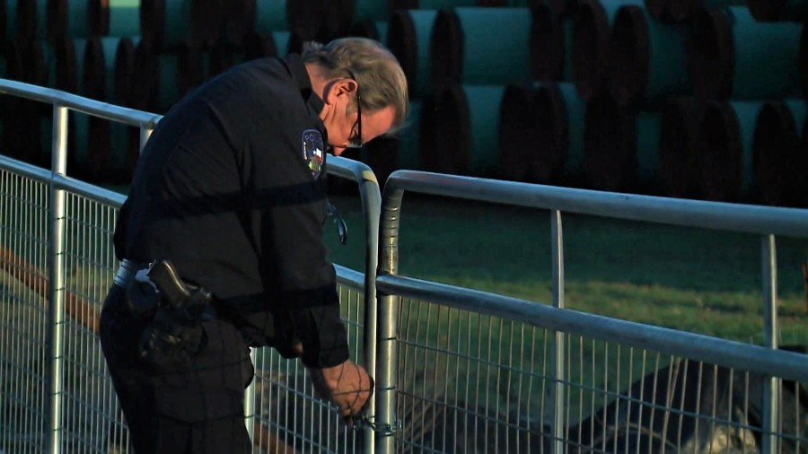 Blanco Police Chief Mike Ritchey uses a combination to unlock a Kinder Morgan pipe yard in Blanco County on March 5, 2020. Ritchey would not tell KXAN who he was contracted with to provide the security detail. (KXAN Photo/Ben Friberg)