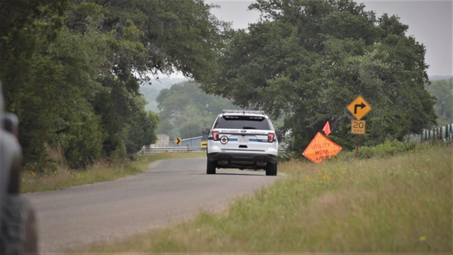 A Blanco County deputy passed by the Kinder Morgan pipe yard on April 28, 2020. The sheriff's office said its deputies are helping with off-duty security work, but the sheriff's office does not maintain any records of that employment. (KXAN Photo/Jody Barr)