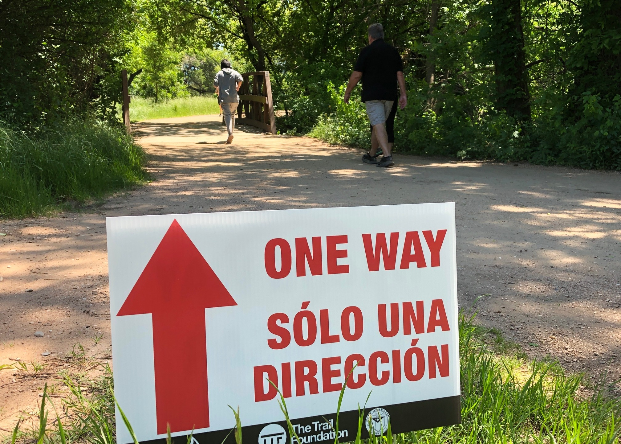 one way signs at hike and bike trail