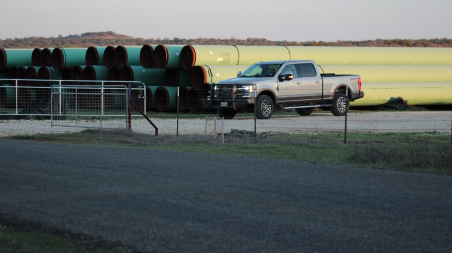 Blanco Police Chief Mike Ritchey stands guard inside the Blanco pipe yard inside this truck on March 5, 2020. Ritchey took 7 photographs during an encounter with KXAN at the site, but the city said they're not public record. (KXAN Photo/Jody Barr)