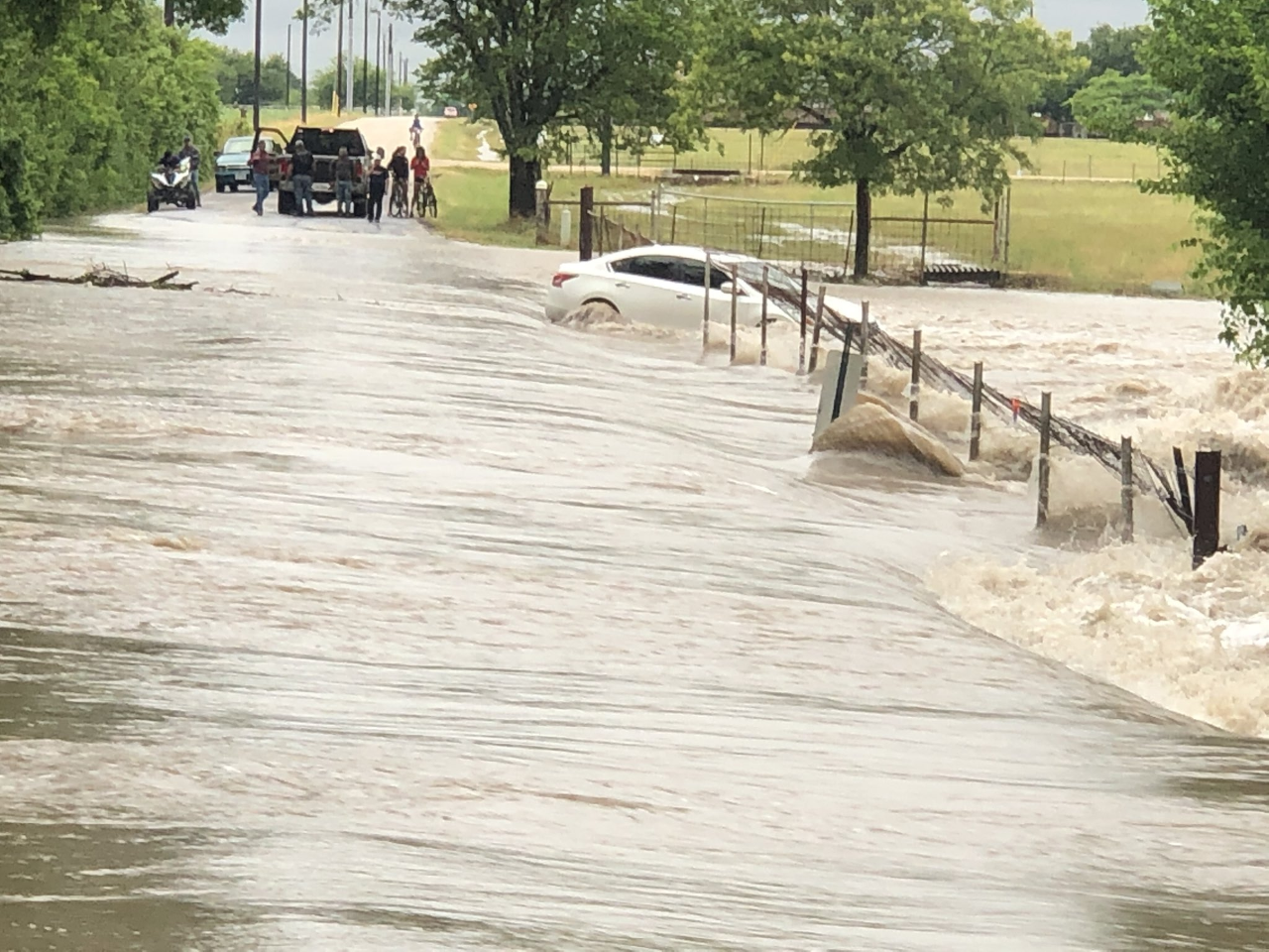 A car was swept into the water on Grist Mill Road in Hays County May 12, 2020 (Travis County Fire Rescue Photo)