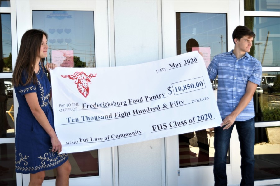 Fredericksburg High School seniors give nearly $11K raised for Six Flags trip to a food bank instead