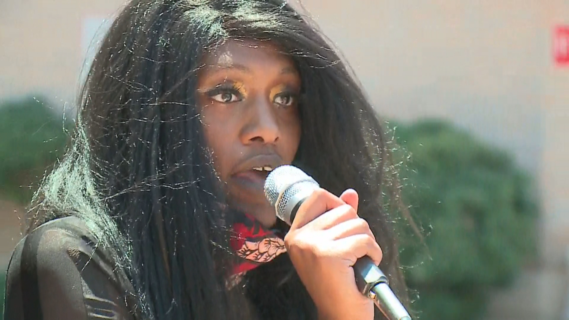 Saraneka Martin speaks in front of APD headquarters June 12, 2020 about being shot in the stomach with a rubber bullet (KXAN Photo)