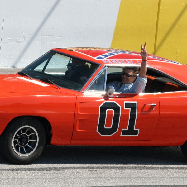 "FILE - In this March 9, 2008, file photo, actor John Schnieder, star of the 1980's television show ""The Dukes of Hazzard"", waves from the General Lee before the Kobalt Tools 500 auto race at Atlanta Motor Speedway in Hampton, Ga. (AP Photo/Dale Davis, File)"