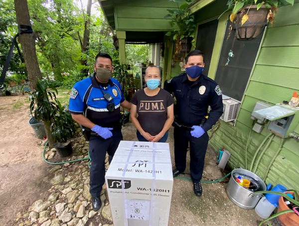 Austin police officers drop off air conditioning units for families in need