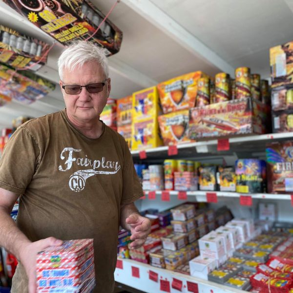 Neill Williamson sells fireworks at the Lakeway American Fireworks stand (KXAN Photo/Kaitlyn Karmout)