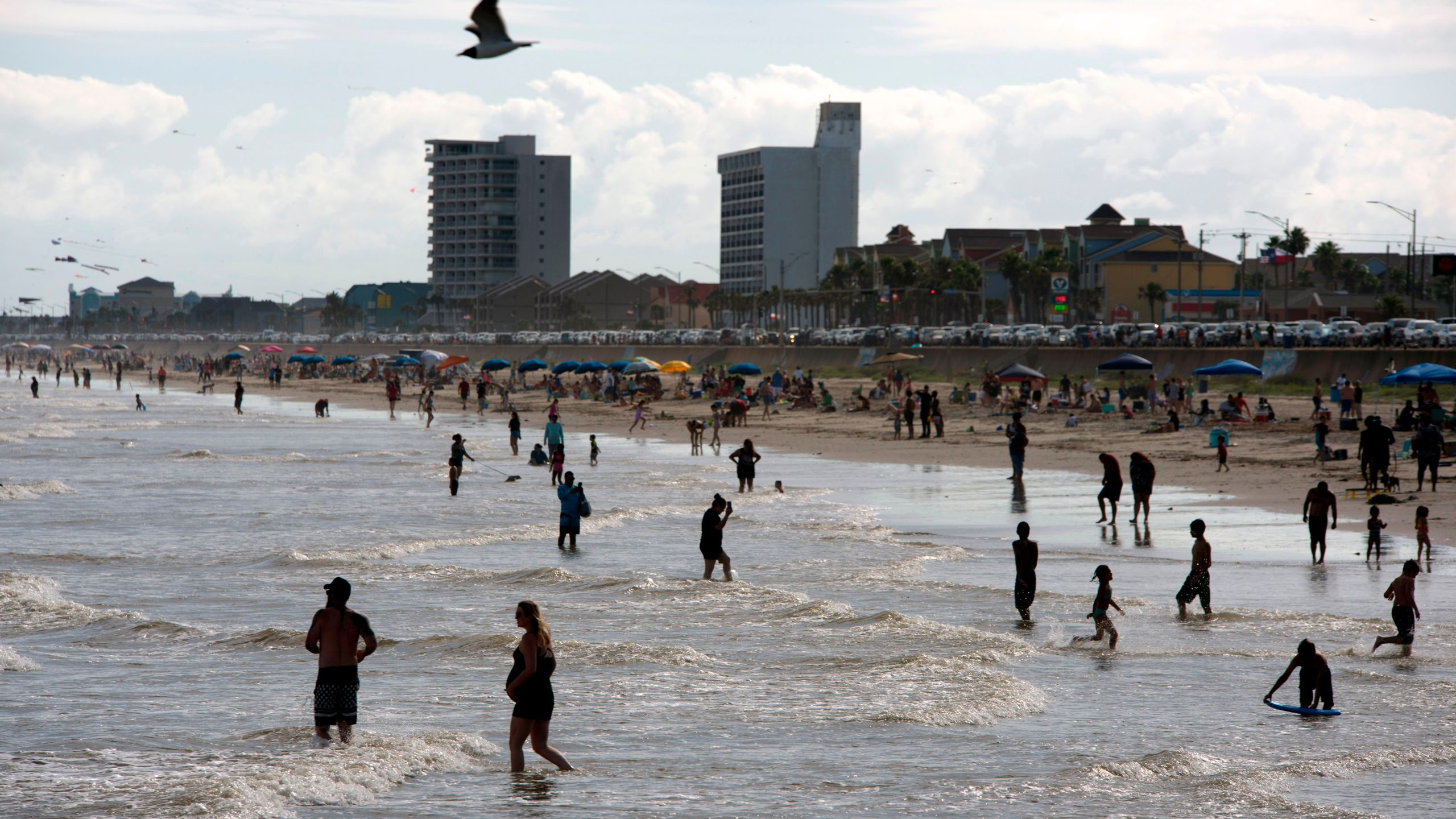 Beachgoers enjoy a day of sunshine at Galveston Beach on May 2, 2020 in Galveston, Texas. (Photo by MARK FELIX/AFP /AFP via Getty Images)