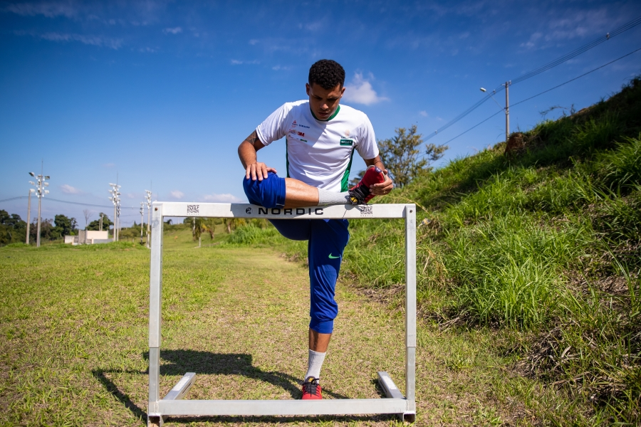 CAMPINAS, BRAZIL - JULY 03: Brazilian Athlete Marcio Teles warms up before a training session on a lawn in front of his house amidst the coronavirus (COVID-19) pandemic on July 3, 2020 in Campinas, Brazil. Marcio is a 400-meter hurdle runner and is qualified for the next Tokyo Olympics Games. He is a four-time Brazilian champion and three times world champion. (Photo by Buda Mendes/Getty Images)