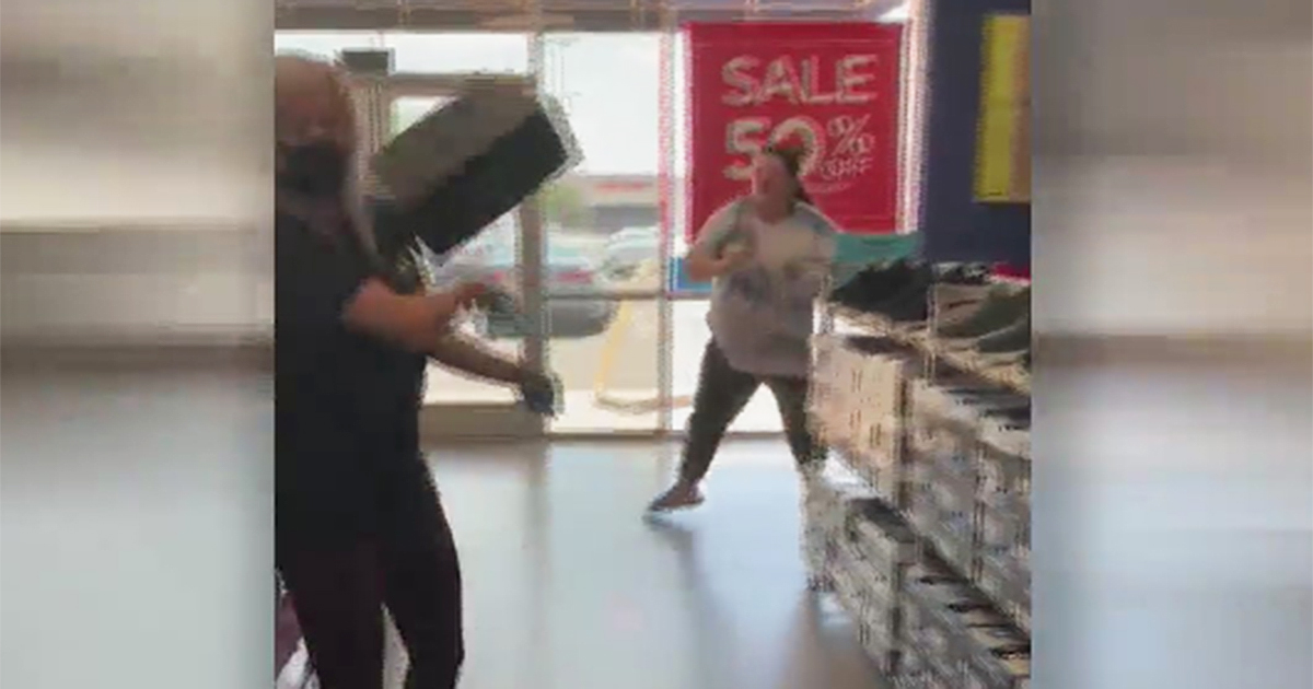 Oklahoma City - Woman throws shoes at employee
