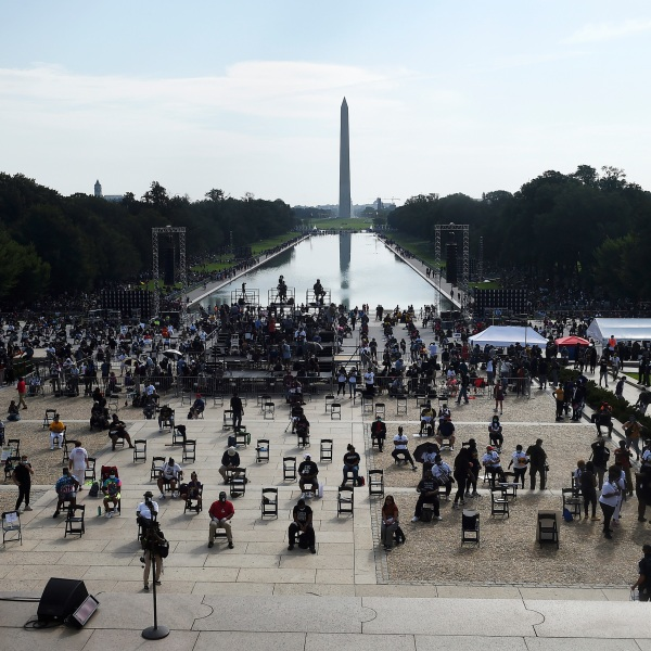 "Demonstrators gather at the Lincoln Memorial as final preparations are made for the March on Washington, Friday Aug. 28, 2020, at the Lincoln Memorial in Washington, on the 57th anniversary of the Rev. Martin Luther King Jr.'s ""I Have A Dream"" speech. (Olivier Douliery/Pool via AP)"