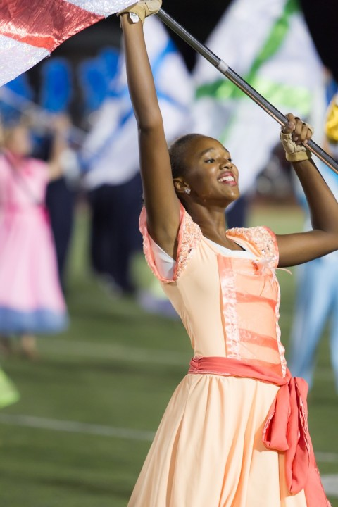 """In this photo, Jules Shelby, Westlake High School class of 2016, is seen performing in the 2014 UIL 6A State Marching Contest. A member of the color guard, Shelby was required to twirl a colorful Confederate flag. When KXAN asked about the performance, the district apologized: """"We agree this performance is not acceptable, and we sincerely regret the choices that were made."""" (Courtesy Jules Shelby)"""